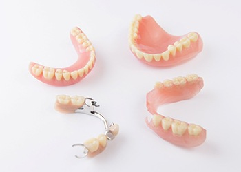 Several different types of dentures in Midland on white background