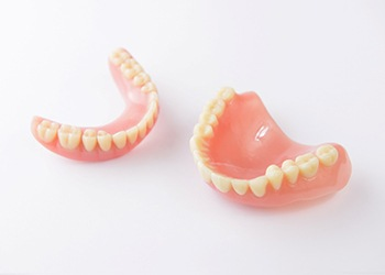Closeup of full dentures in Midland on white background